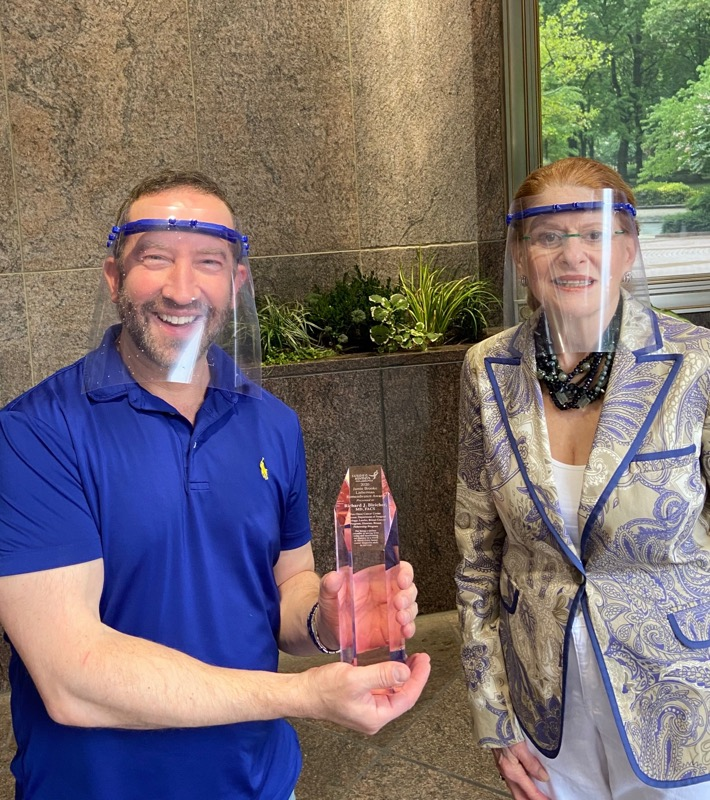 Dr. Richard Bleicher receives the 2020 Jamie Brooke Lieberman Remembrance Award from Elaine I. Grobman, Susan G. Komen Philadelphia's chief executive officer