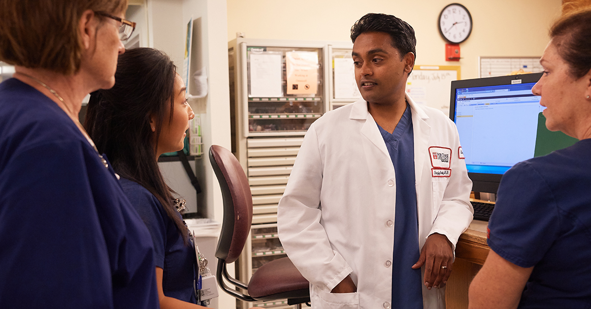 Patients who have had pancreatic cancer surgery must be followed closely after their operation. Reddy takes time to discuss patient care and the plan each night with the staff who will be by his patient's side.