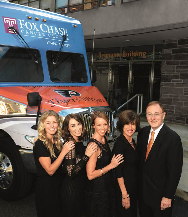 Flyers Wives Jessica Schultz, Olivia VandeVelde, Erinn Hakstol and Mary Ann Saleski with Fox Chase President and CEO Richard I. Fisher, MD