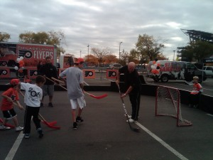 Flyers alumni, Bob Kelly, shoots with the kids.