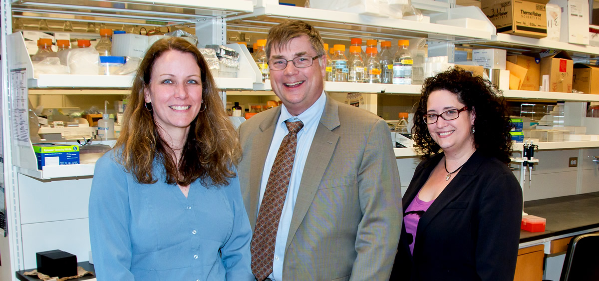 Left to right: Alana O'Reilly; J. Robert Beck, MD, Senior Vice-President and Chief Academic Officer; Dara Ruiz-Whalen. [photo: Joe Hurley]