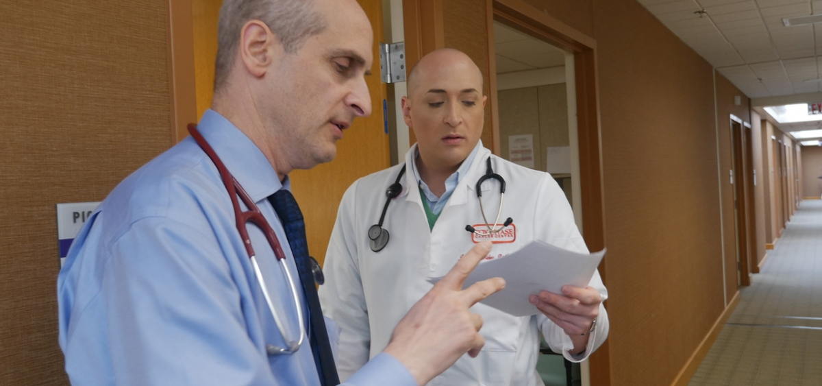Alan Haber, the director of pulmonary service, reviews a pleural disease case with Registered Nurse Jonathan Bidey.