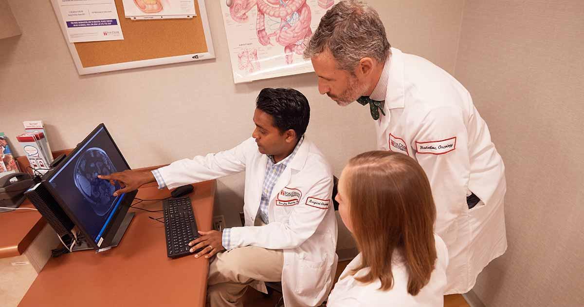 Reddy discusses a particular pancreatic case with other specialists and experts in their field. The multidisciplinary approach that patients get at Fox Chase provides them with the expertise and opinions of a variety of specialists.