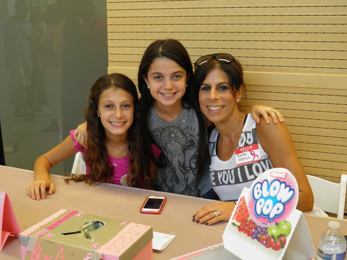 "Renee's daughters held a lollipop fundraiser to ""Blow Out Breast Cancer."""