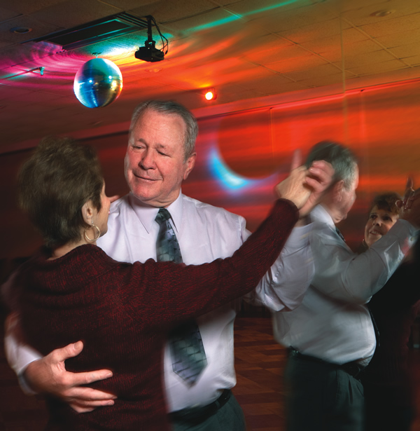 John and his wife, Lucy, are big fans of ballroom dancing.