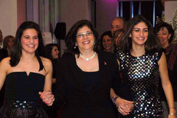 Barbara flanked by two of her daughters.