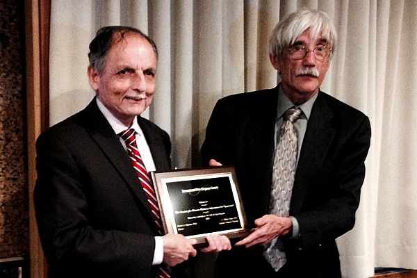 2016 Award to SARI accepted by Mohan Doss (left) from Ed Calabrese, April 19, 2016