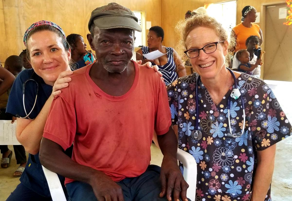 Fox Chase Cancer Center nurses, Nicole Seeley and Sandi Wetherbee, with patient at medical clinic in Port-Au-Prince, Haiti