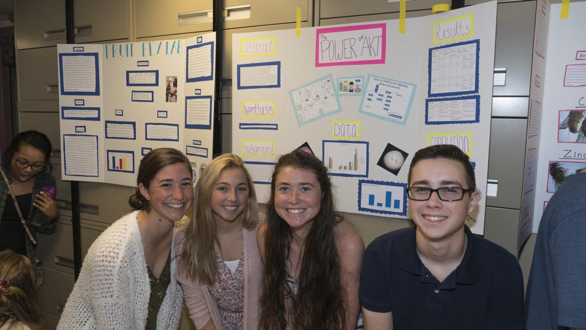 Students pose with their scientific poster