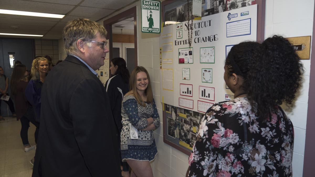 Student present their posters to Dr. Beck, chief academic officer at Fox Chase