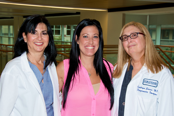 Patti is pictured with her medical oncologist, Lori Goldstein (left) and her radiologist, Kathy Evers (right).