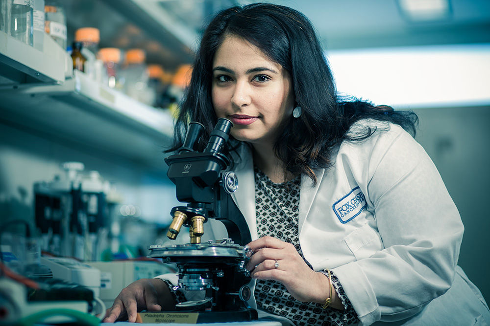 Sanjeevani Arora of the Cancer Prevention and Control Program is researching the effectiveness of treatments for colorectal cancer. She is shown here at the microscope used to identify the Philadelphia chromosome at Fox Chase in 1959, the first conclusive evidence linking cancer and genetics.
