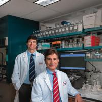 Alfonso Bellacosa, MD, PhD, (left) and Joseph R. Testa, PhD, in the lab Image courtesy of Colin Lenton