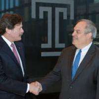 Dr. Larry Kaiser, President and CEO of Temple University Health System (left) and Dr. Michael Seiden, President and CEO of Fox Chase Cancer Center, shake hands after closing on the final agreement that brings Fox Chase Cancer Center into Temple University Health System.
